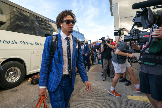 Texas quarterback Casey Thompson walks from the bus into the Cotton Bowl stadium before an NCAA college football game against Oklahoma, Saturday, Oct. 9, 2021, in Dallas. (AP Photo/Jeffrey McWhorter)