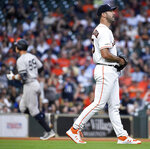 Houston Astros starting pitcher Justin Verlander, right, walks away from the mound as New York Yankees' Aaron Judge, back left, rounds the bases after hitting a solo home run during the fifth inning of a baseball game, Monday, April 8, 2019, in Houston. (AP Photo/Eric Christian Smith)