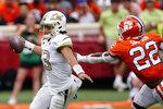 Georgia Tech quarterback Jordan Yates (13) tries to escape from Clemson linebacker Trenton Simpson (22) in the first half of an NCAA college football game Saturday, Sept. 18, 2021, in Clemson, S.C. (AP Photo/John Bazemore)