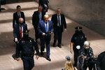 President Donald Trump arrives at the Hart Senate Office Building on Capitol Hill in Washington before meeting with Republican Senators at their weekly luncheon, Tuesday, May 19, 2020. Following Trump are White House Senior Adviser Jared Kushner, top left, and White House chief of staff Mark Meadows. (AP Photo/Patrick Semansky)