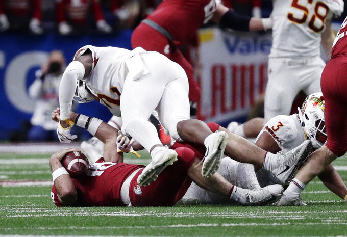 Washington State quarterback Gardner Minshew (16) is hit by Iowa State linebacker Willie Harvey (2) during the the first half of the Alamo Bowl NCAA college football game, Friday, Dec. 28, 2018, in San Antonio. Harvey was called for targeting and ejected from the game. (AP Photo/Eric Gay)