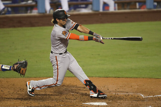 San Francisco Giants' Mauricio Dubon hits an RBI single during the sixth inning of a baseball game against the Los Angeles Dodgers, Sunday, July 26, 2020, in Los Angeles. (AP Photo/Jae C. Hong)