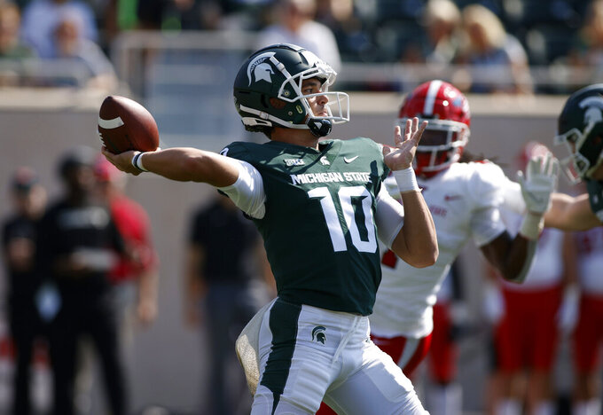 Michigan State quarterback Payton Thorne throws a 75-yard touchdown pass off a flea-flicker on the first play from scrimmage against Youngstown State in the first quarter of an NCAA college football game, Saturday, Sept. 11, 2021, in East Lansing, Mich. (AP Photo/Al Goldis)