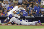 Los Angeles Dodgers' Matt Kemp reaches third from first on a single by Max Muncy as San Diego Padres third baseman Christian Villanueva waits for the throw during the third inning of a baseball game Wednesday, July 11, 2018, in San Diego. (AP Photo/Gregory Bull)
