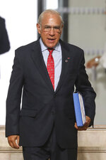 The Organization for Economic Co-operation and Development (OECD) Secretary General Jose Angel Gurria arrives in Biarritz, southwestern France, Sunday Aug. 25, 2019. Fissures emerged among G-7 leaders on Sunday over how to deal with the threat of a global recession, China and Iran, casting deep uncertainty over this year's summit of the world's major democracies as U.S. President Donald Trump appeared increasingly isolated among a gathering of the country's closest allies. (Ludovic Marin/Pool via AP)