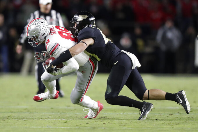 Purdue safety Jacob Thieneman (41) tackles Ohio State tight end Luke Farrell (89) during the first half of an NCAA college football game in West Lafayette, Ind., Saturday, Oct. 20, 2018. (AP Photo/Michael Conroy)