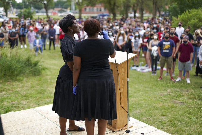 "In this June 19, 2020, photo, singers perform ""Lift Every Voice and Sing,"" dubbed as the Black national anthem, in Lincoln, Neb., during a Juneteenth rally. Juneteenth is the holiday celebrating the day in 1865 that enslaved black people in Galveston, Texas, learned they had been freed from bondage, more than two years after the Emancipation Proclamation. (AP Photo/Nati Harnik)"
