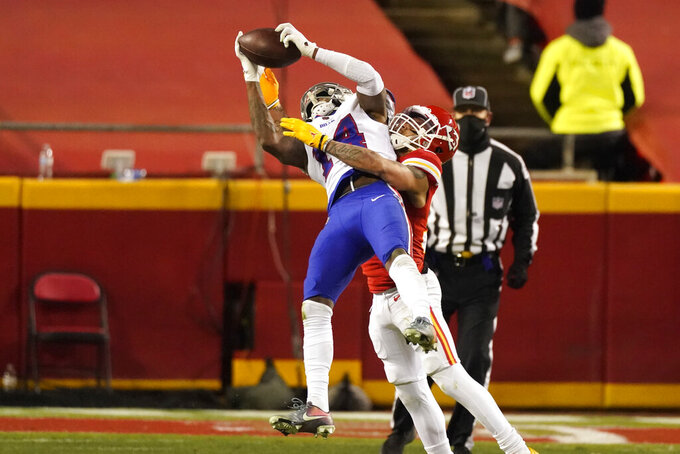 Buffalo Bills wide receiver Stefon Diggs is tackled by Kansas City Chiefs safety Tyrann Mathieu, right, after catching a pass during the second half of the AFC championship NFL football game, Sunday, Jan. 24, 2021, in Kansas City, Mo. (AP Photo/Charlie Riedel)