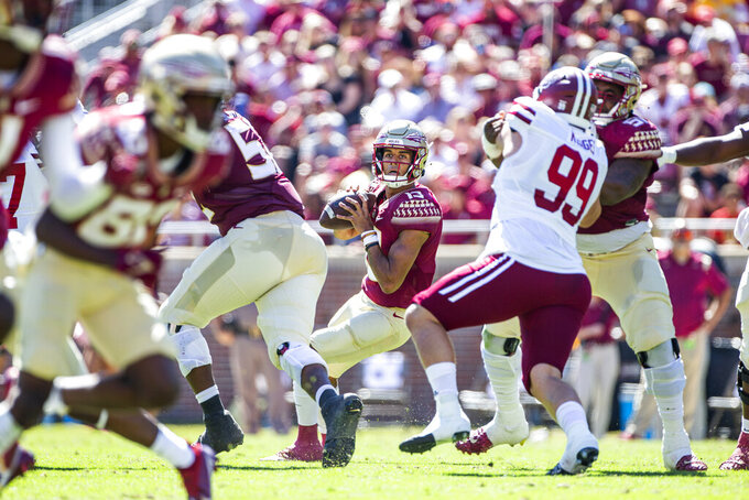 Florida State quarterback McKenzie Milton (10) passes in the first half of an NCAA college football game against Massachusetts in Tallahassee, Fla., Saturday, Oct. 23, 2021. (AP Photo/Mark Wallheiser)