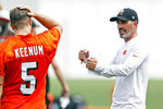 Cleveland Browns head coach Kevin Stefanski talks with quarterback Case Keenum NFL football practice at the team's training facility, Wednesday, June 9, 2021, in Berea, Ohio. (AP Photo/Ron Schwane)