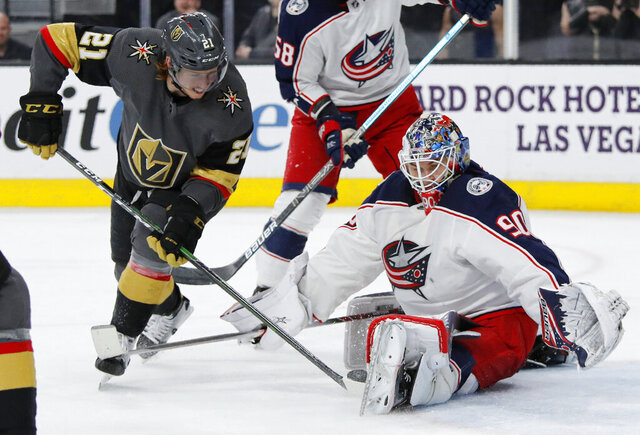 Columbus Blue Jackets goaltender Elvis Merzlikins (90) blocks a shot by Vegas Golden Knights center Cody Eakin (21) during the second period of an NHL hockey game Saturday, Jan. 11, 2020, in Las Vegas. (AP Photo/John Locher)