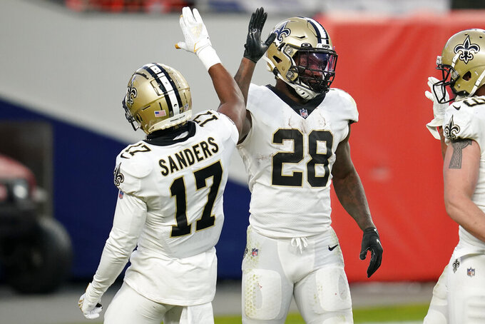 New Orleans Saints running back Latavius Murray (28) celebrates his touchdown run with wide receiver Emmanuel Sanders (17) during the second half of an NFL football game against the Denver Broncos, Sunday, Nov. 29, 2020, in Denver. (AP Photo/David Zalubowski)
