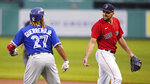 Boston Red Sox starting pitcher Nathan Eovaldi, right, jokes with Toronto Blue Jays designated hitter Vladimir Guerrero Jr. (27) during the first inning of a baseball game at Fenway Park, Monday, June 14, 2021, in Boston. (AP Photo/Charles Krupa)