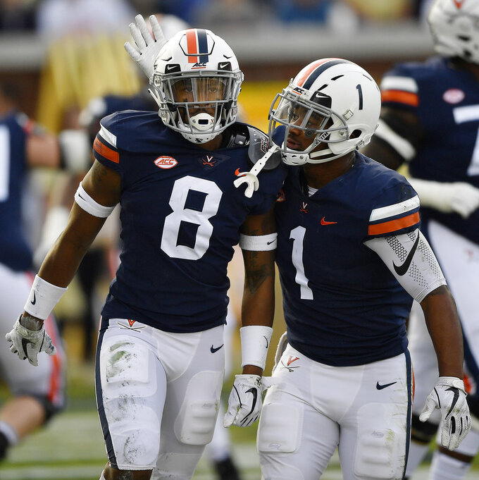 Virginia wide receiver Hasise Dubois (8) celebrates his touchdown catch with Virginia running back Jordan Ellis (1) against Georgia Tech during the first half of an NCAA football game, Saturday, Nov. 17, 2018, in Atlanta. (AP Photo/Mike Stewart)