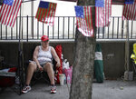 Rose Brown and other Trump supporters line up and camp on 4th Street in downtown Tulsa, Okla., ahead of President Donald Trump's Saturday's campaign rally, Friday, June 19, 2020. (Mike Simons/Tulsa World via AP)