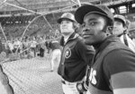 FILE - In this Tuesday, Oct. 7, 1980, file photo, former Cincinnati Reds teammates,  Phillies' Pete Rose, left, and Astros' Joe Morgan stand together watching the Phillies finish batting practice before a National League playoff baseball game in Philadelphia. Hall of Famer Joe Morgan has died. A family spokesman says he died at his home Sunday, Oct. 11, 2020, in Danville, Calif. (AP Photo/File)