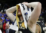 Wofford's Matthew Pegram walks off the court after losing to Kentucky in a second-round game in the NCAA men's college basketball tournament in Jacksonville, Fla., Saturday, March 23, 2019. (AP Photo/John Raoux)