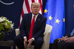 President Donald Trump speaks to reporters about impeachment during a meeting European Commission President Ursula von Der Leyen at the World Economic Forum, Tuesday, Jan. 21, 2020, in Davos, Switzerland. (AP Photo/ Evan Vucci)