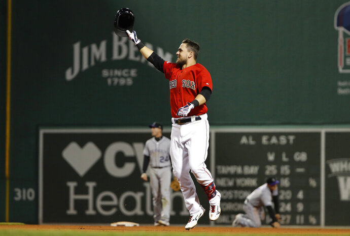 Boston Red Sox's Michael Chavis celebrates his walk-off RBI single against the Colorado Rockies during the 10th inning of a baseball game Wednesday, May 15, 2019, at Fenway Park in Boston. The Red Sox won 6-5. (AP Photo/Winslow Townson)