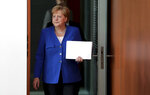 German Chancellor Angela Merkel arrives for the weekly cabinet meeting at the Chancellery in Berlin, Germany, Wednesday, Aug. 21, 2019. (AP Photo/Michael Sohn)
