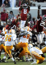 FILE - In this Oct. 24, 2009, file photo, Alabama defensive lineman Terrence Cody (62), left, blocks a field goal by Tennessee kicker Daniel Lincoln (26) in the closing seconds of the fourth quarter to clinch the Crimson Tide's 12-10 victory in an NCAA college football game at Bryant-Denny Stadium in Tuscaloosa, Ala. Alabama has beaten Tennessee each of the last 11 years by an average margin of 24.5 points. The only close calls during the streak came when Cody blocked a field goal as time expired to preserve a 12-10 triumph and when Derrick Henry's go-ahead touchdown with 2:24 left gave the Tide a 19-14 victory in 2015.  (Mark Almond/The Birmingham News via AP, File)