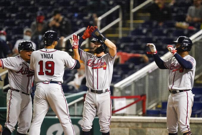 Atlanta Braves' Huascar Ynoa celebrates his grand slam during the sixth inning of baseball game against the Washington Nationals at Nationals Park, Tuesday, May 4, 2021, in Washington. (AP Photo/Alex Brandon)
