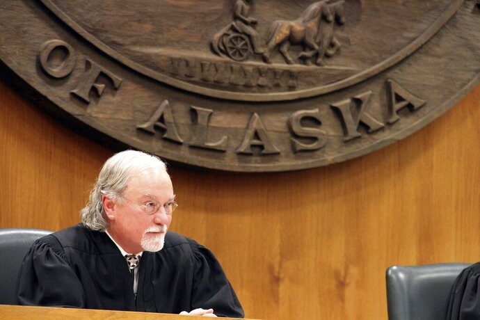 Alaska Supreme Court Justice Craig Stowers listens to arguments in a lawsuit that claims state policy on fossil fuels is harming the constitutional right of young Alaskans to a safe climate Wednesday, Oct. 9, 2019, in Anchorage, Alaska. Sixteen Alaska youths in 2017 sued the state, claiming that human-caused greenhouse gas emission leading to climate change is creating long-term, dangerous health effects. They lost in Superior Court, but appealed to Alaska's highest court. (AP Photo/Mark Thiessen)