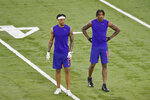 Clemson football player Diondre Overton, left, and Tee Higgins run drills during NFL Pro Day Thursday, March 12, 2020, in Clemson, S.C. (AP Photo/Richard Shiro)