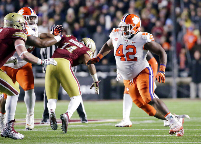 FILE - In this Nov. 10, 2018, file photo, Clemson defensive lineman Christian Wilkins (42) rushes in against Boston College in the second half of an NCAA college football game in Boston. There's little question where No. 2 Clemson has a clear edge on Notre Dame: It's playoff experience. The undefeated Tigers are in their fourth straight College Football Playoff while the unbeaten Fighting Irish are in the final four for the first time. (AP Photo/Elise Amendola, file)