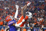 Virginia wide receiver Hasise Dubois (8) scores a touchdown against Florida defensive back Marco Wilson, left, during the first half of the Orange Bowl NCAA college football game, Monday, Dec. 30, 2019, in Miami Gardens, Fla. (AP Photo/Brynn Anderson)