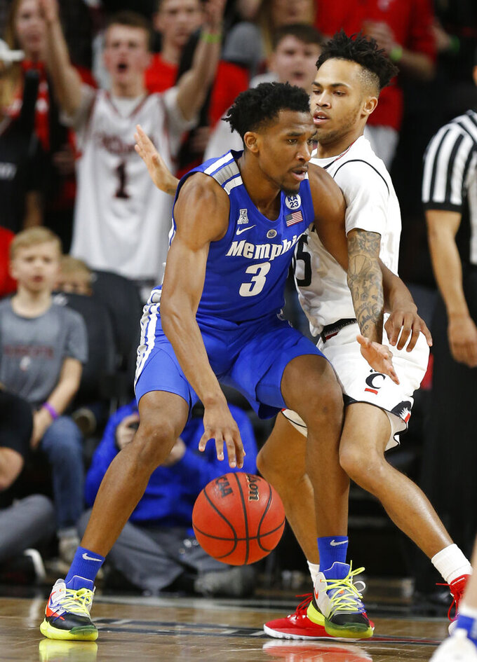 Cincinnati guard Cane Broome, right, pressures Memphis guard Jeremiah Martin (3) during the first half of an NCAA college basketball game Saturday, March 2, 2019, in Cincinnati. (AP Photo/Gary Landers)