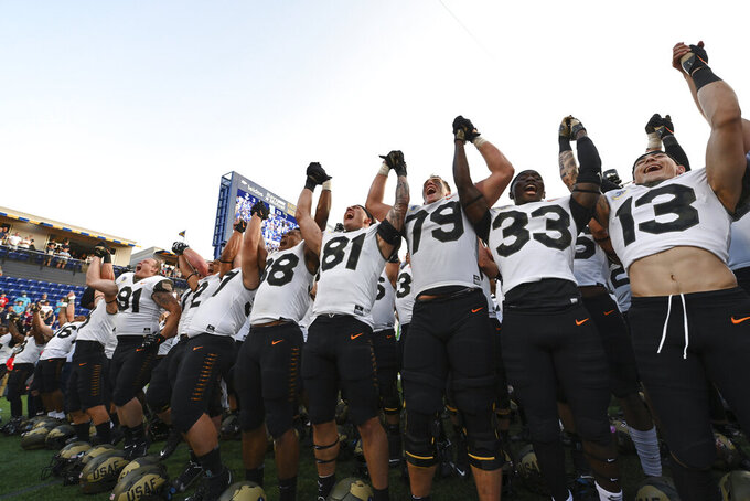 Air Force players sing their fight song after defeating Navy in an NCAA college football game, Saturday, Sept. 11, 2021, in Annapolis, Md. (AP Photo/Terrance Williams)