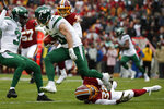 New York Jets wide receiver Braxton Berrios runs past Washington Redskins strong safety Montae Nicholson (35) in the first half of an NFL football game, Sunday, Nov. 17, 2019, in Landover, Md. (AP Photo/Alex Brandon)