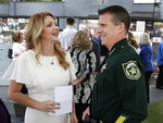 Barbara Poma, left, CEO of the onePulse foundation, talks with Orange County Sheriff John Mina before a news conference to introduce legislation that would designate the Pulse nightclub site as a national memorial, Monday, June 10, 2019, in Orlando, Fla. (AP Photo/John Raoux)