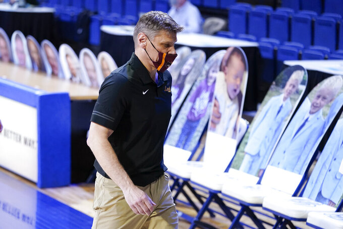 Loyola of Chicago head coach Porter Moser walks off the court after an NCAA college basketball game against Drake, Sunday, Feb. 14, 2021, in Des Moines, Iowa. Drake won 51-50 in overtime. (AP Photo/Charlie Neibergall)