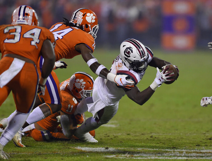 South Carolina's Deebo Samuels stretches out for a first down during the second half of an NCAA college football game against Clemson Saturday, Nov. 24, 2018, in Clemson, S.C. (AP Photo/Richard Shiro)