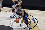 Villanova's Justin Moore works around Boston College's Rich Kelly during the second half of an NCAA college basketball game Wednesday, Nov. 25, 2020, in Uncasville, Conn. (AP Photo/Jessica Hill)