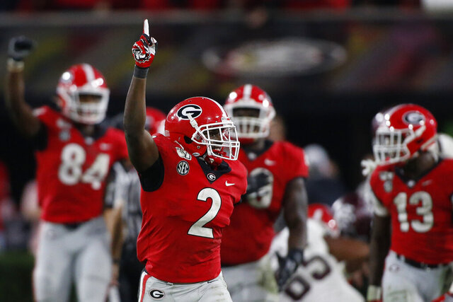 FILE - In this Nov. 23, 2019, file photo, Georgia defensive back Richard LeCounte (2) celebrates after a stop in the first half of an NCAA college football game against Texas A&M, in Athens, Ga. LeCounte was selected to The Associated Press All-America first team, Tuesday, Aug. 25, 2020. (Joshua L. Jones/Athens Banner-Herald via AP)/Athens Banner-Herald via AP)