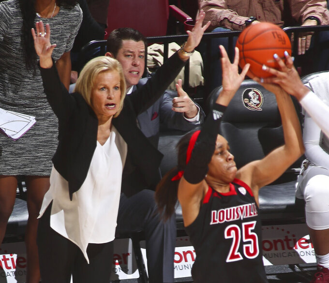 Florida State coach Sue Semrau tries to get her team to pressure Louisville guard Asia Durr (25) during the first half of an NCAA college basketball game in Tallahassee, Fla., Thursday, Jan. 24, 2019. (AP Photo/Phil Sears)