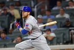 Chicago Cubs' Ben Zobrist watches his base hit that drove in the go-ahead run in the ninth inning of a baseball game against the Atlanta Braves on Tuesday, May 15, 2018, in Atlanta. Chicago won 3-2. (AP Photo/John Bazemore)