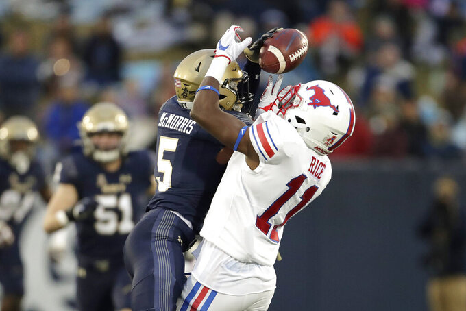 Navy cornerback Michael McMorris (5) breaks up a pass intended for SMU wide receiver Rashee Rice (11) during the first half of an NCAA college football game, Saturday, Nov. 23, 2019, in Annapolis, Md. (AP Photo/Julio Cortez)