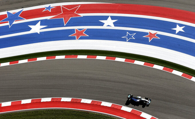 "FILE - In this Oct. 31, 2014, file photo, Mercedes driver Nico Rosberg, of Germany, drives through the course during the first practice session for the Formula One U.S. Grand Prix auto race at the Circuit of the Americas in Austin, Texas. Formula One expects to race the U.S. Grand Prix at the Circuit of the Americas for ""many years to come,"" a series official said Tuesday, May 28, 2019, despite the track's failed effort to secure $25 million in Texas public money it was denied in 2018. Sean Bratches, F1's managing director of commercial operations, suggested the series remains confident in the Texas race's' financial security. (AP Photo/Eric Gay, File)"