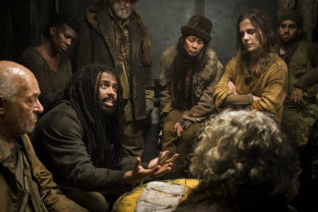 This image released by TNT shows Daveed Diggs, seated second left, and Katie McGuinness, standing second left, from the sci-fi series