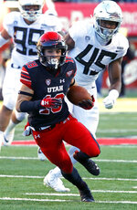Utah wide receiver Britain Covey (18) carries the ball as Oregon defensive lineman Gus Cumberlander (45) pursues in the first half during an NCAA college football game Saturday Nov. 10, 2018, in Salt Lake City. (AP Photo/Rick Bowmer)
