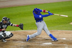 Chicago Cubs' Victor Caratini hits a two-run home run against the Chicago White Sox during the sixth inning of a baseball game in Chicago, Friday, Sept. 25, 2020. (AP Photo/Nam Y. Huh)