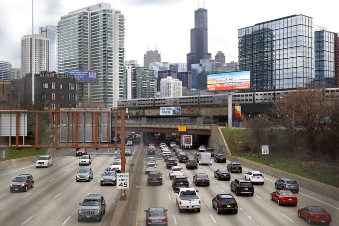 FILE - In this Wednesday, March 31, 2021 file photo, traffic flows along Interstate 90 highway as a Metra suburban commuter train moves along an elevated track in Chicago. Because of quality concerns caused by the pandemic, data from one of the Census Bureau's most comprehensive surveys, providing a wide-ranging picture of the U.S. annually on everything from commute times to education levels, won't be released in its usual format this year, officials said Thursday, July 29. (AP Photo/Shafkat Anowar, File)