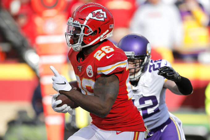 Kansas City Chiefs running back Damien Williams (26) gestures as he runs for a 91-yard touchdown against Minnesota Vikings safety Harrison Smith (22), during the second half of an NFL football game in Kansas City, Mo., Sunday, Nov. 3, 2019. (AP Photo/Colin E. Braley)