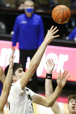 Purdue center Zach Edey (15) goes up for a layup during the first half of an NCAA men's basketball game, Saturday, Dec. 12, 2020, in West Lafayette, Ind. (Nikos Frazier/Journal & Courier via AP)