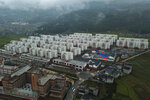 An aerial view shows apartments built by the Chinese government for ethnic minority in Yuexi county, southwest China's Sichuan province on Sept. 11, 2020. The ruling Communist Party says its initiatives have helped to lift millions of people out of poverty. Yi ethnic minority members were moved out of their mountain villages in China's southwest and into a newly built town in an anti-poverty initiative. (AP Photo/Sam McNeil)