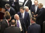 Former State Senator Cal Cunningham of Lexington, N.C., center, mingles with lawmakers prior to the unveiling of a portrait of former Senate President Pro Tempore Marc Basnight on Tuesday, September 21, 2021 at the General Assembly in Raleigh, N.C. (Robert Willett/The News & Observer via AP)